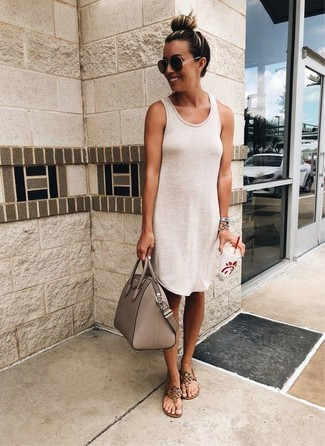 Show off your playful side in a cream tank dress. A pair of thong sandals fits right in here. Ideal for summer, this combo will gain quite a few likes on the 'gram too.