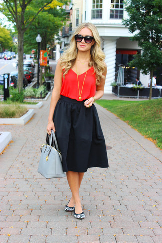 Stay stylish on busy days in a red tank and a black full skirt. This outfit is complemented perfectly with baby blue suede ballet flats.