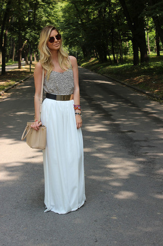 A white and black animal tank and a white pleated maxi skirt is a smart combination to add to your casual lineup. It is indeed possible to keep your cool under the crazy heat. The proof is right here.