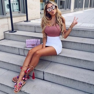 How to wear: pink tank, white mini skirt, beige leather knee high gladiator sandals, pink quilted leather crossbody bag
