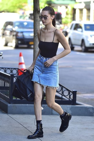 How to wear: black tank, light blue denim mini skirt, black leather lace-up flat boots, black socks
