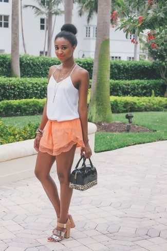 How to wear: white silk tank, orange shorts, silver leather heeled sandals, black leopard rubber satchel bag