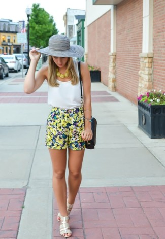 If you're all about being comfortable when it comes to putting together an outfit, this combination of a white tank and a Diesel Cowbow Hat is what you need. Grey elastic heeled sandals will bring a classic aesthetic to the ensemble. What an exciting idea for spring and summer!