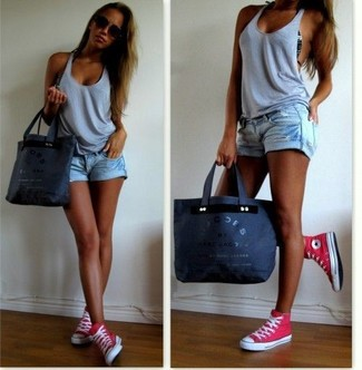 Rock a grey tank with light blue ripped denim shorts for comfort dressing from head to toe. Hot pink high top sneakers will add some edge to an otherwise classic outfit. You can bet this combination will become your favorite when hot weather hits.