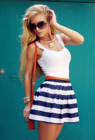 The versatility of a white tank and a white and navy horizontal striped skater skirt makes them investment-worthy pieces.