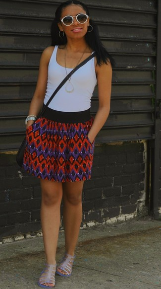 Try teaming a white tank with a red and navy chevron skater skirt for an easy to wear look. Complement this look with clear rubber gladiator sandals.