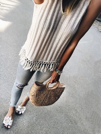 How to Wear a White Knit Tank For Women: Why not consider pairing a white knit tank with light blue ripped skinny jeans? As well as totally functional, both of these items look incredible together. Complement this look with a pair of white floral canvas flat sandals and off you go looking smashing.