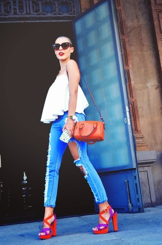 A white pleated tank and baby blue distressed skinny jeans is a great combination to add to your casual repertoire. Orange suede heeled sandals will add elegance to an otherwise simple look.