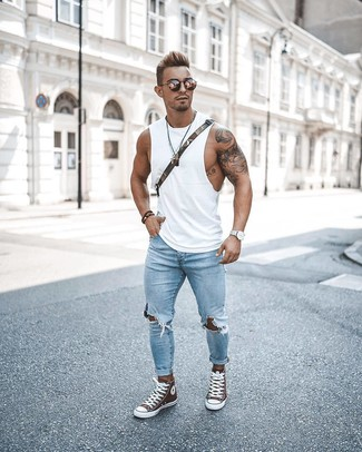 If you're searching for a silhouette that you can rely on on a day off, look no further than this combination of a white tank and light blue ripped skinny jeans. Amp up the cool of your outfit by finishing off with brown high top sneakers. As full-blown summer settled in, it's time for light and breezy getups like this one.