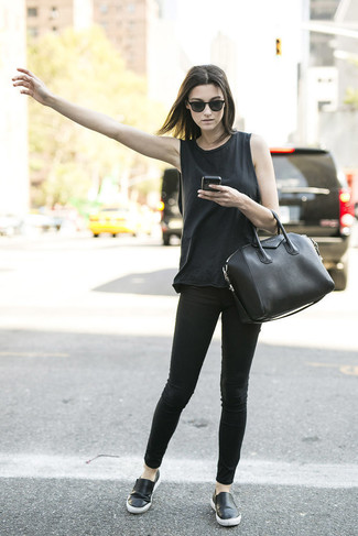 Busy days call for a simple yet stylish outfit, such as a black tank and black slim jeans. Complement this look with black leather slip-on sneakers.