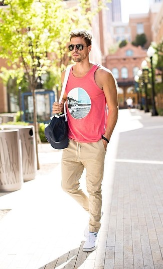 How to wear: pink print tank, beige sweatpants, white plimsolls, black and white canvas duffle bag