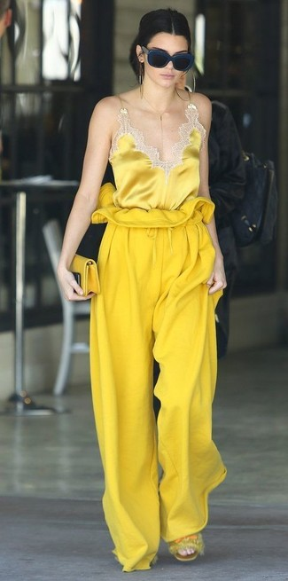 This combination of a yellow silk tank and 3.1 Phillip Lim Wool Drawstring Waist Wide Leg Pants embodies comfort and style. Dress down your look with yellow fur flat sandals. An outfit like this is just what you need to get in the mood for this summer fashion season.