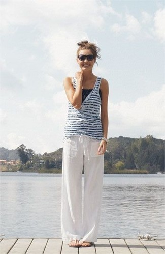 How to wear: white and navy horizontal striped tank, white linen wide leg pants, beige thong sandals, black sunglasses