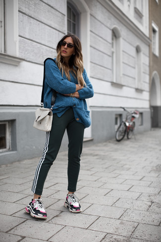 This combo of a cardigan and black sweatpants combines comfortand efficiency and allows you to keep it low profile yet trendy. Multi colored athletic shoes will add a new dimension to an otherwise classic outfit. As you can see here, it's so easy to look awesome and stay warm when fall arrives, all thanks to looks like this one.