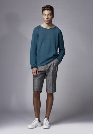 How to wear: teal crew-neck sweater, grey vertical striped shorts, white leather low top sneakers