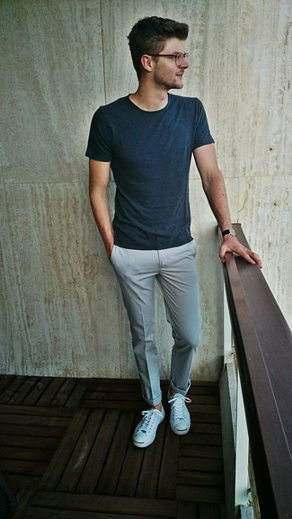 How to Wear a Teal Crew-neck T-shirt For Men: You'll be amazed at how extremely easy it is for any gentleman to get dressed this way. Just a teal crew-neck t-shirt and grey dress pants. Rev up your look by slipping into a pair of white low top sneakers.