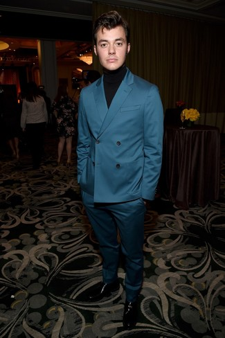 How to wear: teal suit, black turtleneck, black leather loafers