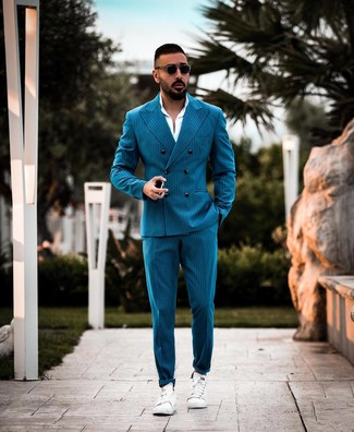 How to wear: teal vertical striped suit, white dress shirt, white leather low top sneakers, black sunglasses