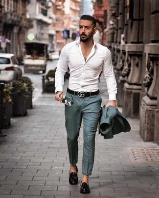 How to Wear a Teal Suit: Hard proof that a teal suit and a white long sleeve shirt look awesome when you pair them together in a polished getup for a modern man. Black leather tassel loafers are a winning footwear option that's also full of character.