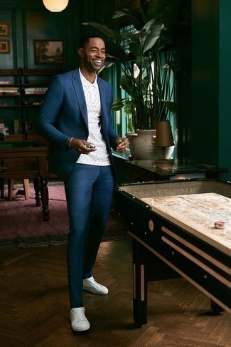 How to Wear a Teal Suit: If you don't take your style lightly, go for elegant style in a teal suit and a white polka dot polo. White canvas low top sneakers will add a more casual spin to an otherwise classic outfit.