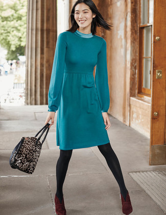 How to wear: teal sweater dress, burgundy suede ankle boots, brown leopard suede tote bag, charcoal tights