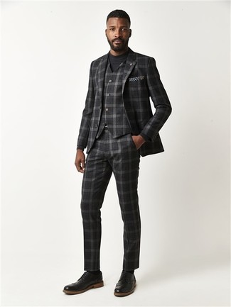 How to wear: charcoal plaid three piece suit, black crew-neck sweater, black leather brogues, black and white polka dot pocket square