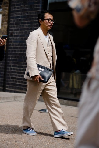 Three Piece Suit Outfits: Try pairing a three piece suit with a white crew-neck t-shirt to assemble an effortlessly neat and put together ensemble. Rounding off with blue canvas low top sneakers is a fail-safe way to infuse a more laid-back touch into this look.