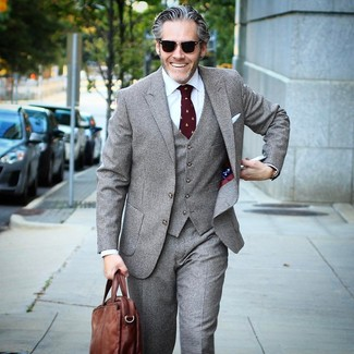 How to wear: grey check three piece suit, white dress shirt, brown leather briefcase, burgundy print tie