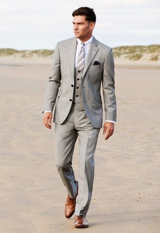 How to wear: grey three piece suit, white dress shirt, brown leather brogues, grey vertical striped tie