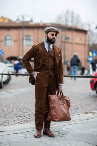 How to wear: brown corduroy three piece suit, light blue vertical striped dress shirt, brown leather brogues, brown leather tote bag