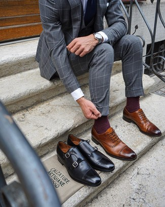 How to wear: grey check three piece suit, white dress shirt, brown leather brogues, navy tie