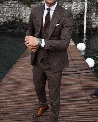How to Wear a Dark Brown Tie For Men: A dark brown three piece suit and a dark brown tie are strong players in any modern gentleman's closet. For a more casual twist, why not complete your outfit with a pair of brown leather brogues?