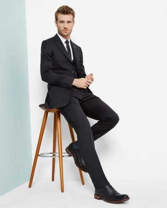 Men's Looks & Outfits: What To Wear In 2020: A black three piece suit and a white dress shirt are a sophisticated outfit that every modern gent should have in his sartorial collection. Complement this ensemble with a pair of black leather brogues to loosen things up.