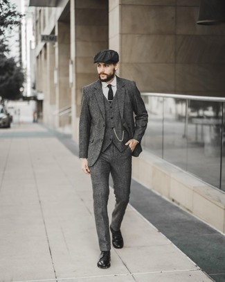 Flat Cap Outfits For Men: This combo of a grey wool three piece suit and a flat cap is hard proof that a pared down casual outfit can still be truly sharp. Tap into some David Beckham stylishness and elevate your outfit with black leather casual boots.