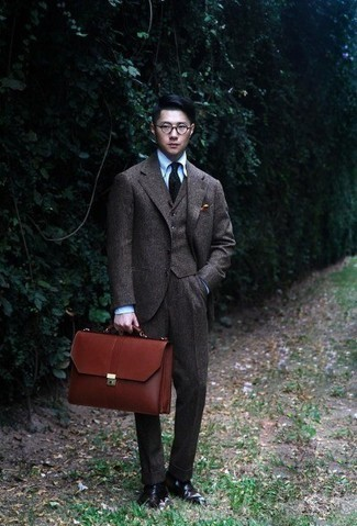 Brown Leather Briefcase Outfits: If you're seeking to take your casual look to a new height, consider wearing a dark brown wool three piece suit and a brown leather briefcase. A pair of dark brown leather chelsea boots will add an elegant twist to your outfit.