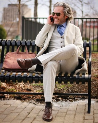 How to wear: beige wool three piece suit, light blue dress shirt, brown leather derby shoes, brown leather briefcase