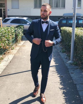 How to wear: navy three piece suit, white dress shirt, brown leather derby shoes, black bow-tie