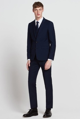 How to Wear a Navy Three Piece Suit: Pairing a navy three piece suit and a white dress shirt will create a classic, rugged silhouette. Add a pair of black leather derby shoes to the equation to make a traditional look feel suddenly edgier.