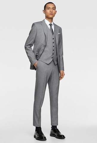 How to Wear a Grey Three Piece Suit: For a look that's nothing less than gasp-worthy, consider teaming a grey three piece suit with a white dress shirt. Introduce black leather derby shoes to the mix to infuse an element of stylish nonchalance into this getup.
