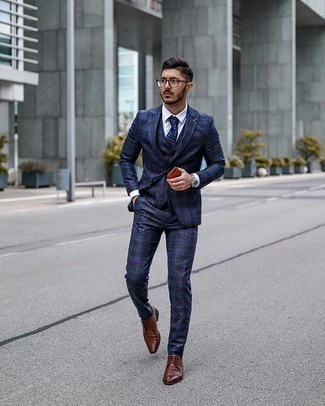 Brown Leather Derby Shoes Outfits: This combo of a navy plaid three piece suit and a white dress shirt is perfect when you need to look like an expert in modern men's style. Play down your outfit with a pair of brown leather derby shoes.