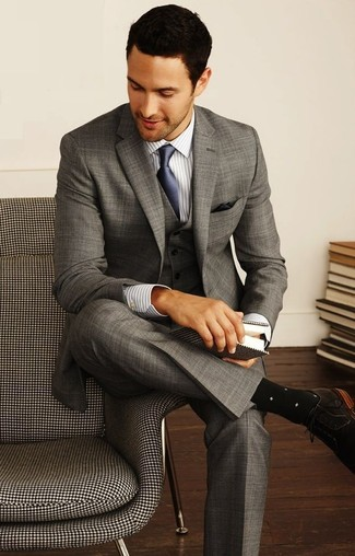 Rock a grey three piece suit with a navy silk tie for a sharp classy look. Dark brown suede derby shoes will give your look an on-trend feel. This one will play especially well when summer days set in.