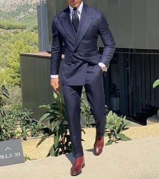 How to Wear a Navy Three Piece Suit: For an outfit that's classic and gasp-worthy, marry a navy three piece suit with a white dress shirt. Tone down your ensemble by rocking burgundy leather desert boots.
