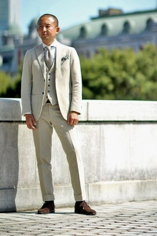 1200+ Warm Weather Outfits For Men: Pair a beige three piece suit with a white dress shirt if you're aiming for a proper, classic outfit. A cool pair of dark brown suede desert boots is an effective way to infuse an element of stylish casualness into your outfit.