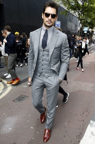 David Gandy wearing Grey Three Piece Suit, White and Black Vertical Striped Dress Shirt, Dark Brown Leather Double Monks, Charcoal Tie