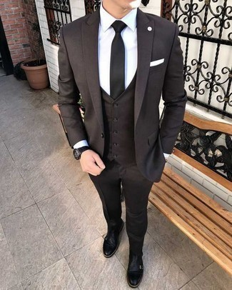 Men's Outfits 2020: A modern gent's classy wardrobe should always include such essentials as a black three piece suit and a white dress shirt. And if you wish to instantly tone down this outfit with one single piece, introduce a pair of black leather double monks to your look.