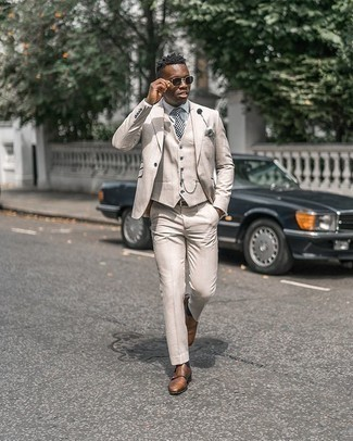 Brown Leather Double Monks Outfits: Irrefutable proof that a beige three piece suit and a white dress shirt are awesome when matched together in a refined getup for today's man. To infuse a laid-back touch into this getup, introduce brown leather double monks to the equation.