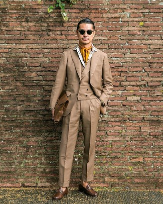 How to wear: tan three piece suit, white print dress shirt, brown leather loafers, brown leather briefcase