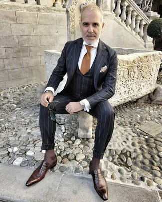 How to wear: black vertical striped three piece suit, white dress shirt, dark brown leather loafers, brown tie