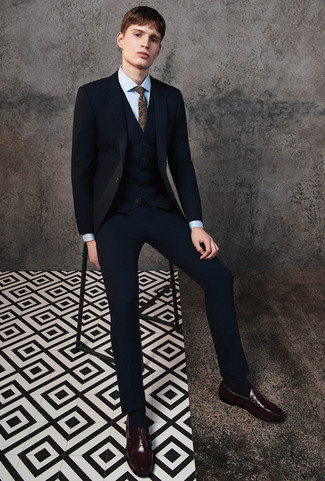 How to wear: black three piece suit, light blue dress shirt, dark brown leather loafers, brown paisley tie