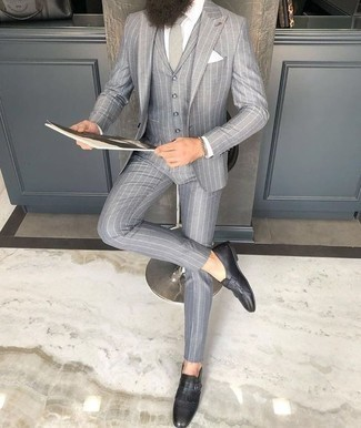 Grey Tie Outfits For Men: Marrying a grey vertical striped three piece suit with a grey tie is an amazing pick for a dapper and elegant ensemble. Get a bit experimental on the shoe front and dial down your outfit by rocking a pair of black fringe leather loafers.